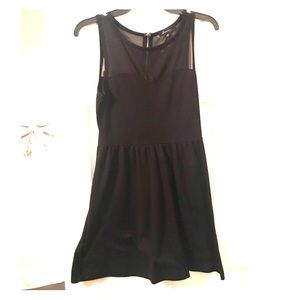 Black sleeveless shear neckline dress